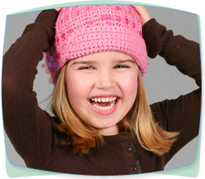 smiling girl in pink hat